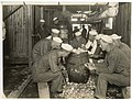 Cadets peeling potatoes at the Naval Training Station, Seattle, circa 1918 (MOHAI 9106).jpg