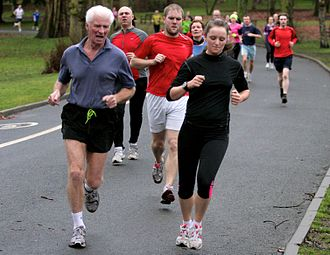 5K run - Runners during a 5K parkrun in Cannon Hill Park, United Kingdom