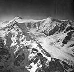 Capps Glacier, one source of valley glacier, bergschrund, and icefall, August 26, 1969 (GLACIERS 6445).jpg