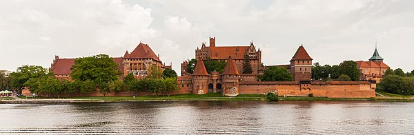 The Malbork Castle, UNESCO World Heritage Site, located near the old city of Malbork, was built in the 13th century by the Teutonic Knights and is the largest castle in the world by surface area.
