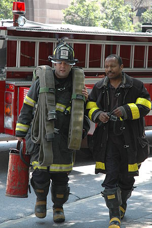Chicago Fire Department - Chicago firefighters responding to a call on Michigan Ave. wearing pre-2006 turnout gear.