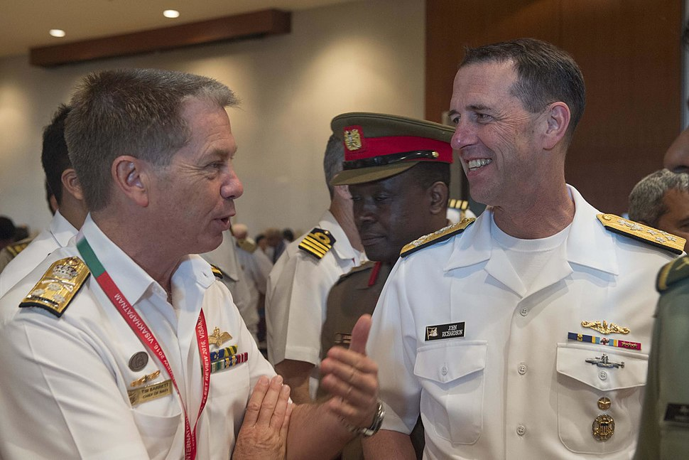 Chief of Naval Operations Adm. John Richardson (CNO) talks with the head of the Royal Australian Navy, Chief of Navy Vice Adm. Tim Barrett, during India's International Fleet Review (IFR) 2016