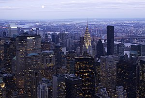 East Side of Midtown Manhattan, showing the terraced crown of the Chrysler Building lit at twilight