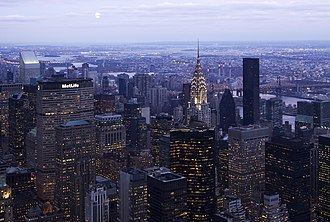 Central business district - Midtown Manhattan in New York City, the largest central business district in the world. Shown is the terraced crown of the Chrysler Building lit at dawn.