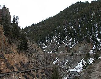Byers Canyon - Byers Canyon, looking upstream. The poles adjacent to the tracks on the left carry alarm wires that stop train traffic in the event of a rockslide