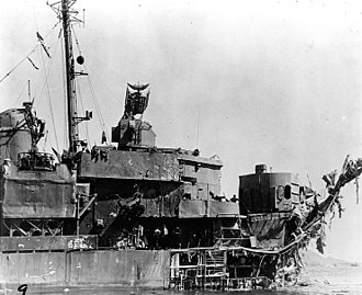 USS Lindsey - View of extensive damage to the ship's forward hull and superstructure, received when she was struck by two kamikaze planes off Okinawa on 12 April 1945.
