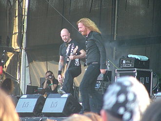 Dark Tranquillity - Dark Tranquillity playing live at Summer Breeze Open Air 2007, with former bassist Michael Niklasson on the left and the vocalist Mikael Stanne on the right.