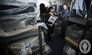 Child grooming - Detective Inspector Kay Wallace surrounded by computers, mobile phones and digital storage devices seized from the homes of suspected paedophiles. Online grooming of youngsters via chat rooms and webcams is an area COST team officers are encountering more and more.