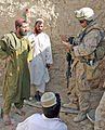 Defense.gov News Photo 100816-M-9426J-001 - U.S. Marine Corps Cpl. Daniel B. Wyss a squad leader with Golf Company 2nd Battalion 9th Marine Regiment collects information from Afghans.jpg