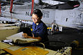 Defense.gov News Photo 110213-N-OK922-036 - U.S. Navy Airman Tracey Gonzales performs maintenance on a mobile electric power plant in the hangar bay of the aircraft carrier USS Carl Vinson.jpg