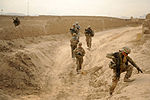 Defense.gov News Photo 111121-F-FT240-033 - U.S. Army Spc. Edwarde Loeup right an automatic rifleman with Provincial Reconstruction Team Zabul moves to high ground during a dismounted.jpg