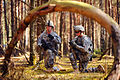 Defense.gov News Photo 120326-A-HE359-141 - U.S. Army soldiers take a tactical pause while approaching their objective during a live fire exercise titled Iron Anvil at Grafenwoehr Training.jpg
