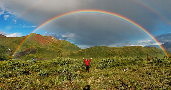 Natural rainbows show a continuum of colors. The photo shows a double rainbow in Alaska.