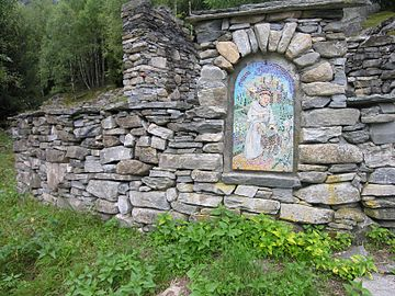Mosaic embedded in stone wall, Italian area of Switzerland DryStoneArt.jpg