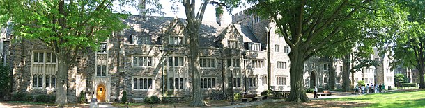 Panoramic photo of a row of three-story Gothic style building exteriors