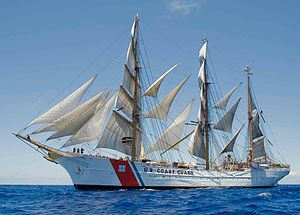 USCGC Eagle under full sail in 2013 in the Caribbean Sea. Photo Courtesy of the U.S. Coast Guard.