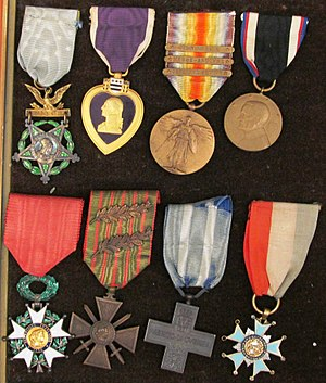 Edward Allworth - Original decorations of WWI Medal of Honor recipient Major Edward C. Allworth in the collection of the United States Army Heritage and Education Center, Carlisle Barracks, Pennsylvania.  First row:  Medal of Honor; Purple Heart; World War I Victory Medal with St. Mihiel, Meuse-Argonne and Defensive Sector battle clasps; Army of Occupation of Germany Medal.  Second row:  French Ordre national de la Légion d'honneur in the degree of Knight; French Croix de guerre 1914-1918 with two bronze palms; Italian Croce al Merito di Guerra and Levi Washington State Diamond Commemorative Medal.