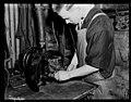 Electrical apprentice at work on Turbo Dynamo Otahuhu workshops. PHOTOGRAPHER J.F. Le Cren DATE 1953.jpg