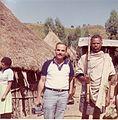 Eli Eliezri with an Ethiopian warrior in Ethiopia in 1984.jpg