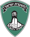 Emblem of Magav.svg