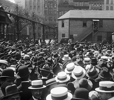 Goldman (shown here in Union Square, New York in 1916) urged unemployed workers to take direct action rather than depend on charity or government aid. Emma Goldman surrounded by crowd.jpg