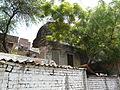 Encroached tomb near Jahaz Mahal (3702500603).jpg