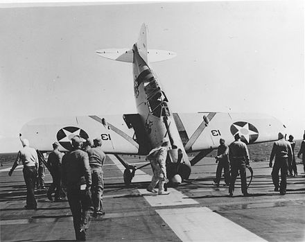 LT John S. Thach tipped this F2A-1 onto its nose on Saratoga, March 1940. F2A Thach accident USS Saratoga (CV-3) 1940.jpg
