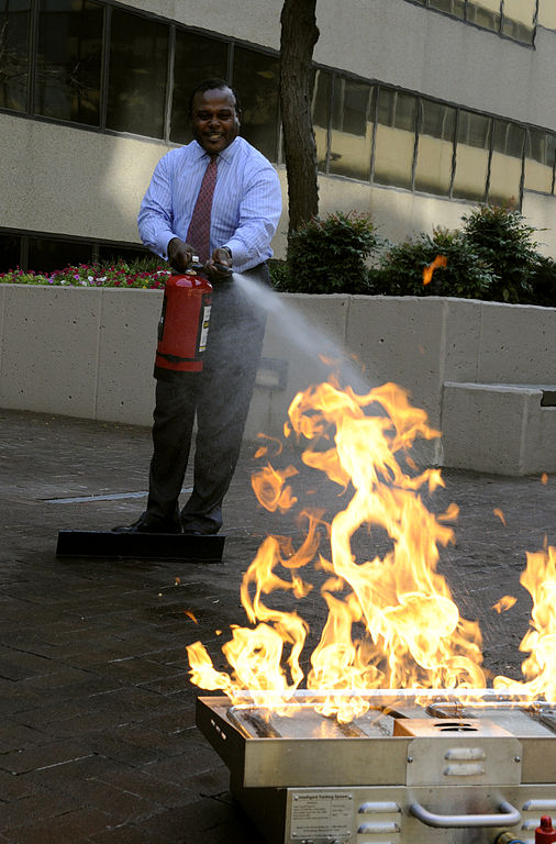 File fema 39129 fema fire safety officer demonstrates - How to put out a fireplace ...