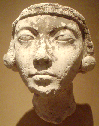 Kiya - A plaster study of a young woman wearing large earrings, generally identified as Kiya, currently on display at the Metropolitan Museum of Art, New York City