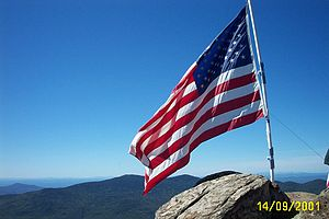 English: Flag proudly flying on the summit of ...