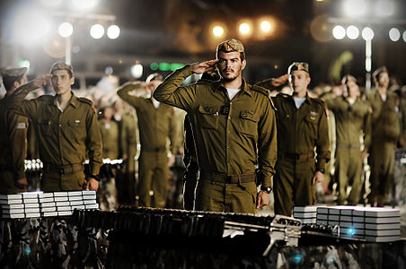 w:en:IDF officers from the Kfir infantry brigade saluting the Israeli flag in a military ceremony, 2011