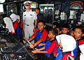 Flickr - Official U.S. Navy Imagery - Lt. j.g. Artemas Richardson, a public affairs officer aboard the USS Dewey (DDG 105) watches 5th grade students from Royal Brunei Navy Primary School.jpg