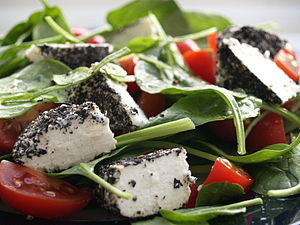 Salad of spinach, plum tomatoes, goat cheese a...