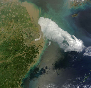 The Moderate Resolution Imaging Spectroradiometer (MODIS) on NASA's Terra satellite captured this natural-color image of a patch of fog off the coast of Eastern China and Shanghai on April 15, 2013.  The patch of fog was rapidly moving north east at that time, and ship wave cloud formations can be seen off the coast of Shanghai caused by air disturbed by small islands. A smaller fog patch also lingers off southern Shanghai's coast can be seen in the image.   Besides Shanghai and fog, on the top left of the image, inter-linking towns can also be seen, along with yellow sediment in the Yellow sea and Eastern China sea.  Proof that fog was in the photo:http://www.webcitation.org/6FtE9drvU