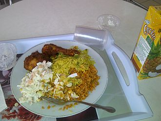 Jollof rice - Fried rice, jollof rice and salad, served with grilled chicken
