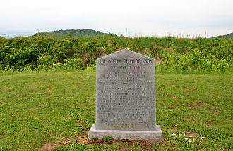 Battle of Fort Davidson - Granite monument behind which stand the earthworks of the fort