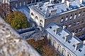 Gargoyle of Notre-Dame de Paris with the Hotel-Dieu hospital in background.jpg