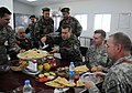Gen. Bismillah Mohammadi serves Lt. Gen. Caldwell (4251492850).jpg