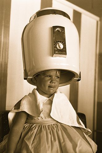 Hair dryer - Girl under beauty parlor hair dryer, 1958
