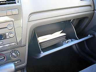 Glove compartment - The glove compartment of a Ford Fusion with an owner's manual visible.
