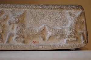 Elam - An ornate design on this limestone ritual vat from the Middle Elamite period depicts creatures with the heads of goats and the tails of fish