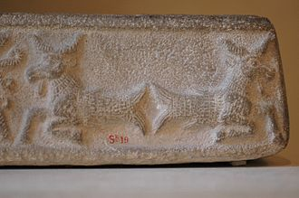 Elam - An ornate design on this limestone ritual vat from the Middle Elamite period depicts creatures with the heads of goats and the tails of fish.