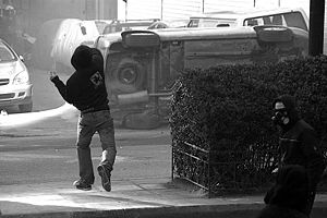 2008 Greek riots - Two rioters in the streets of Athens