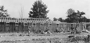 New York State Office of Parks, Recreation and Historic Preservation - Workers completing a Civilian Conservation Corps barracks in 1934 at Green Lakes State Park in Fayetteville, New York
