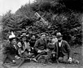 Group of people sitting on grass with dog, June 24, 1899 (WASTATE 2568).jpeg