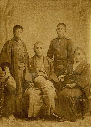 Saitō Hajime - Saitō, 53, is seated with his second son Tsuyoshi, his eldest son Tsutomu, and his wife Tokio in 1897.