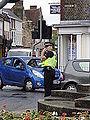 Hampshire Police officer directing traffic through Newport High Street.JPG