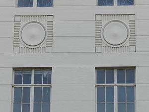 Alex Giualini Plaza - Motifs on the old City Hall building