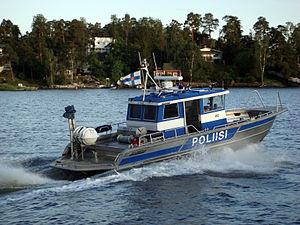 Police of Finland - Helsinki Police Department's patrol boat, Ville 3 (designation 493), speeding away.
