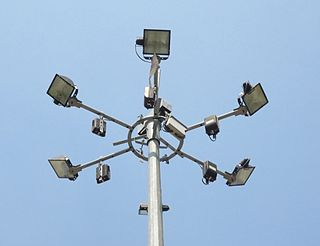 High-mast lighting a tall pole with lighting attached to the top pointing towards the ground